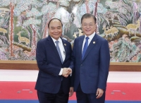 Thủ tướng Nguyễn Xuân Phúc và Tổng thống Hàn Quốc Moon Jae-in - Ảnh: VGP
