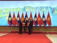 Bộ trưởng Trần Hồng Hà và Bộ trưởng Sommad Pholsena ký kết và trao đổi Bản ghi nhớ hợp tác